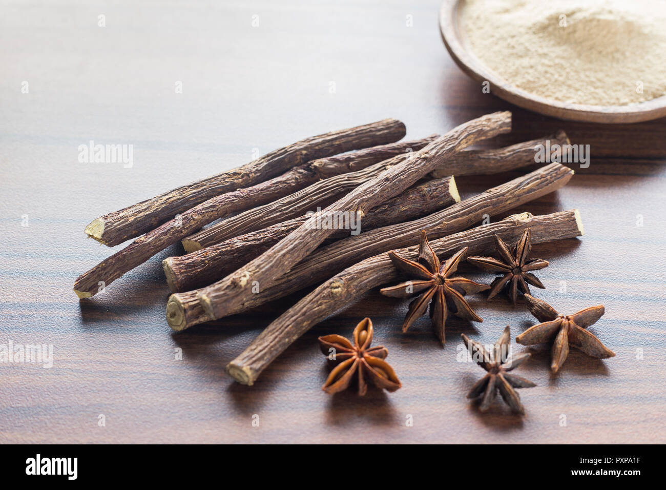 licorice root and anise on the table - Glycyrrhiza glabra. - Stock Image