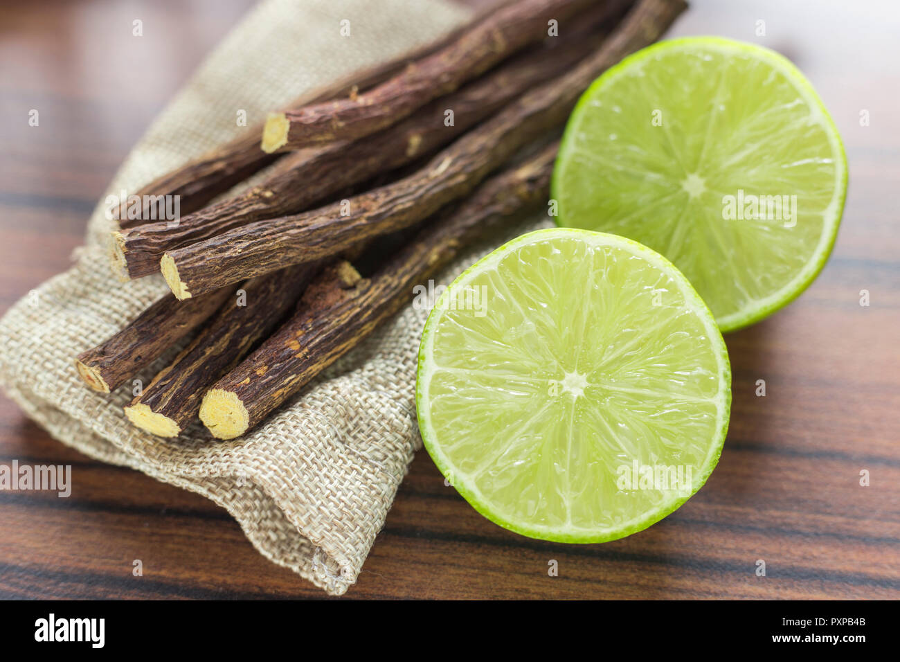 licorice root and lemon on the table - Stock Image