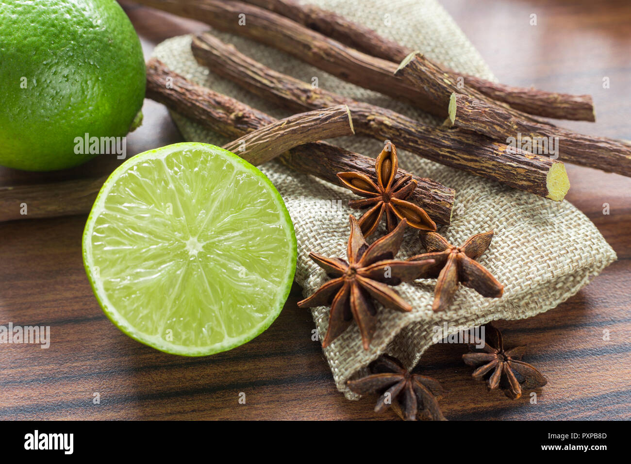 licorice root, lemon and anise on the table. - Stock Image