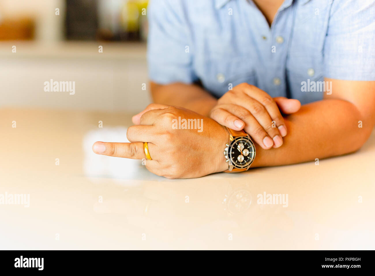 Man Pointing His Ring Finger With Gold Wedding Ring On His Finger