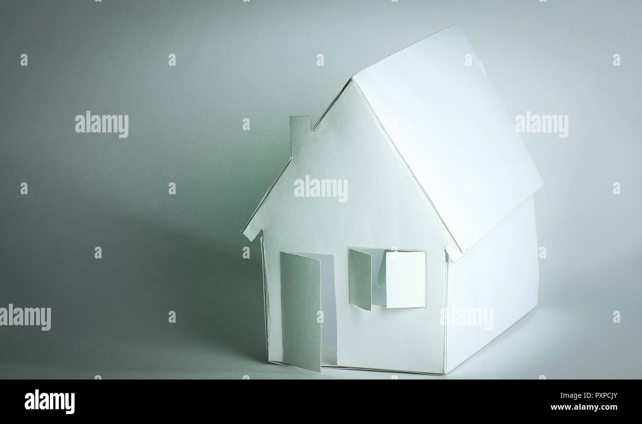 paper house paper background.the concept of a mortgage - Stock Image