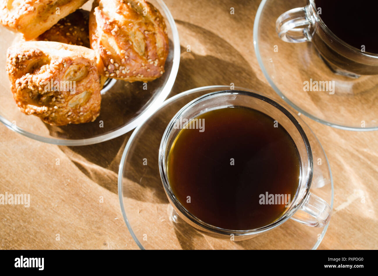 Two cups of coffee and pies on wooden table. Coffee break. Good morning concept. - Stock Image