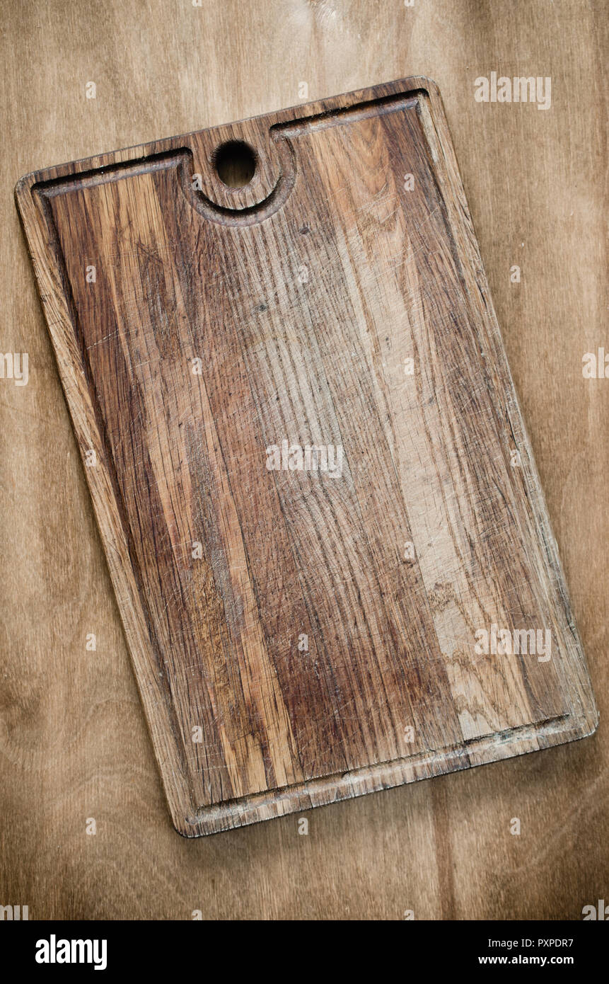 Wooden Cutting Board on Rustic Table For Kitchen Background ...