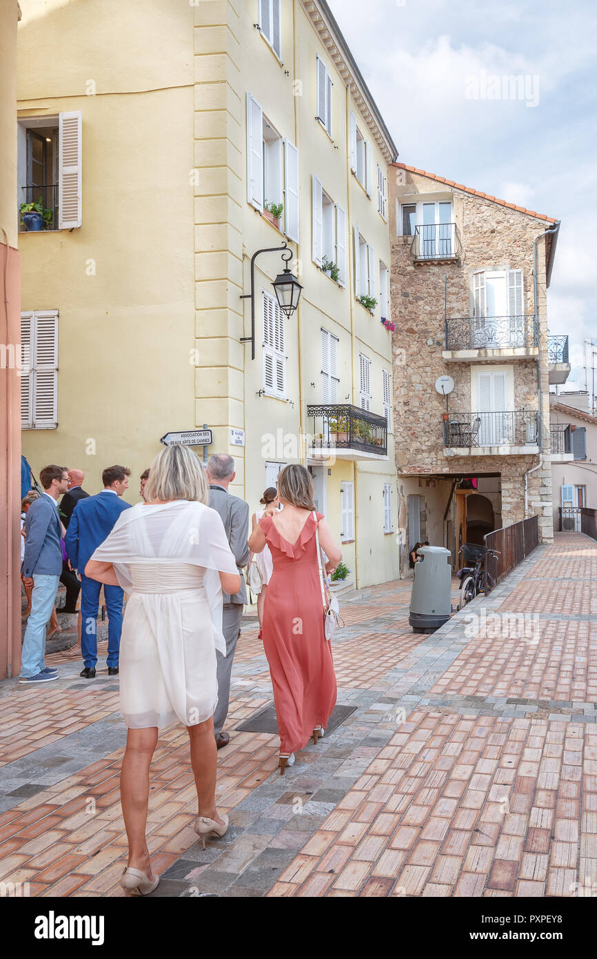 Cannes, France, September 15, 2018:  Wedding guests on their way to the Catholic church Notre Dame d'Esperange in Cannes - Stock Image
