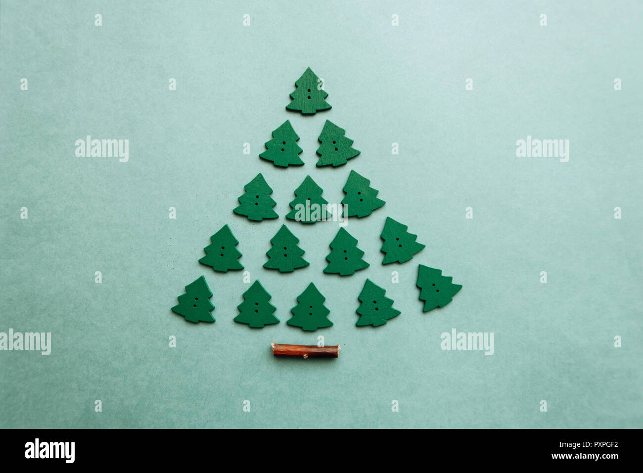 creative idea in minimalistic style for christmas or new year themes christmas tree from other small wooden christmas trees celebratory concept
