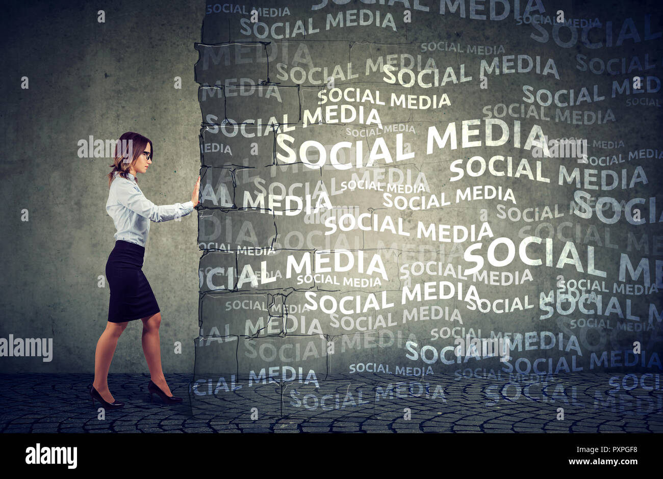 Business woman determined to stop social media pressure and influence - Stock Image