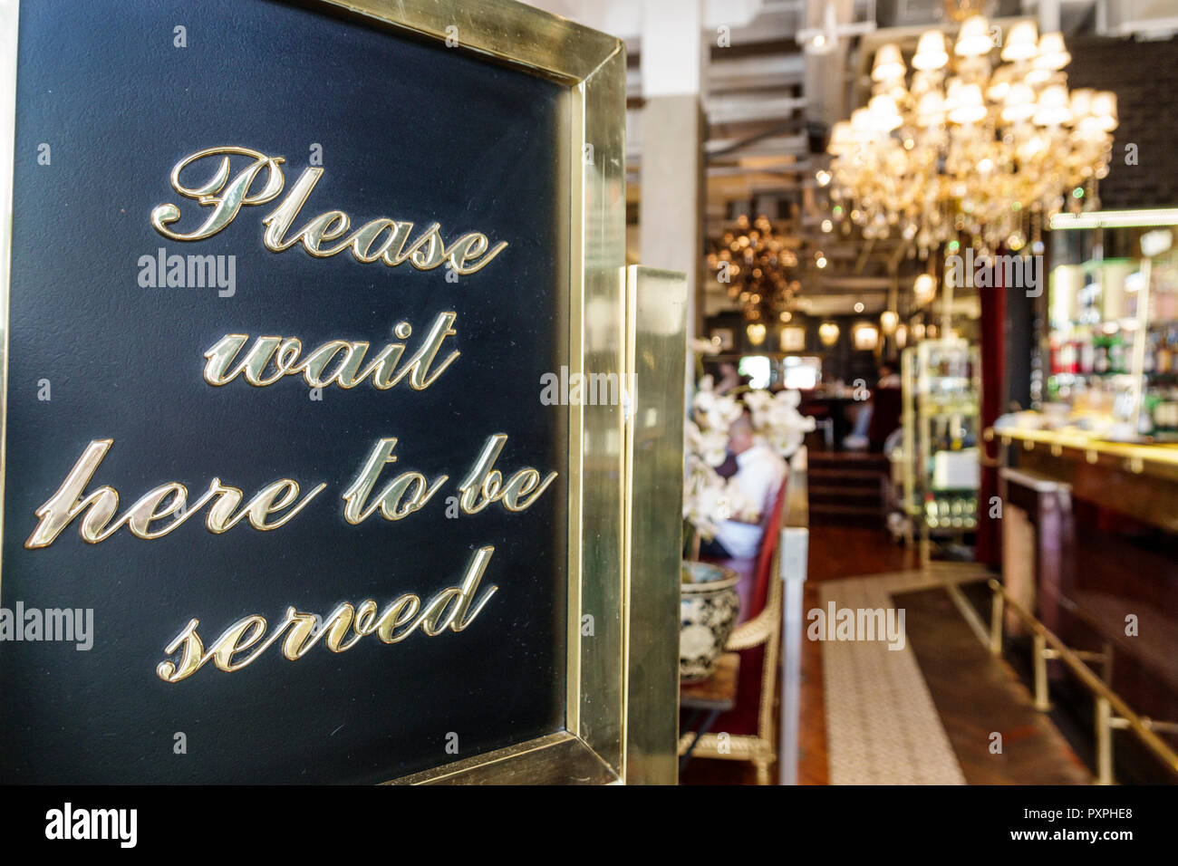 London England United Kingdom Great Britain Piccadilly Mayfair Caffe Concerto Piccadilly restaurant Italian entrance host sign wait to be served - Stock Image
