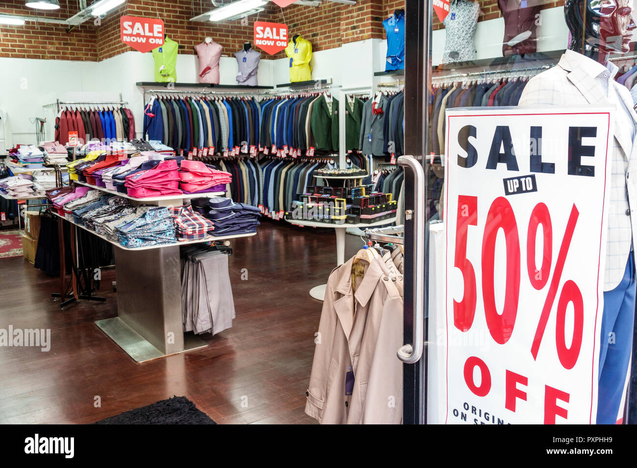 London England United Kingdom Great Britain Piccadilly Mayfair Sergio Uomo shopping men's clothing store interior entrance display sale sign sale 50% - Stock Image