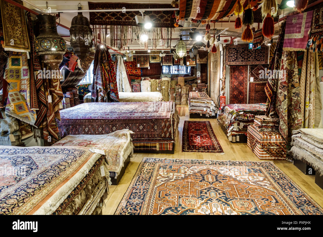 London England United Kingdom Great Britain Soho Liberty Department Store shopping luxury brands upmarket home decor oriental rugs display sale - Stock Image