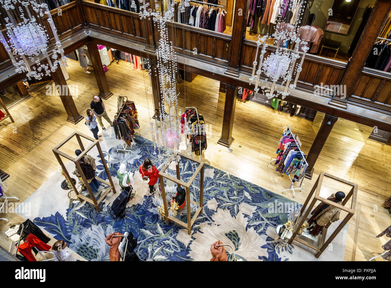 London England United Kingdom Great Britain Soho Liberty Department Store shopping luxury brands upmarket atrium lightwell overhead view railings disp - Stock Image