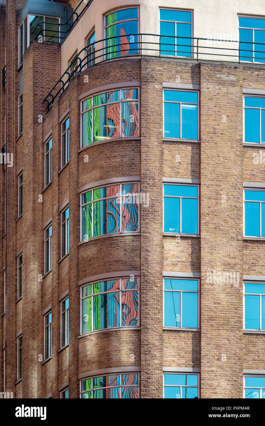 Central St Giles buildings reflecting in office block glass windows in Shaftesbury avenue, London, England - Stock Image