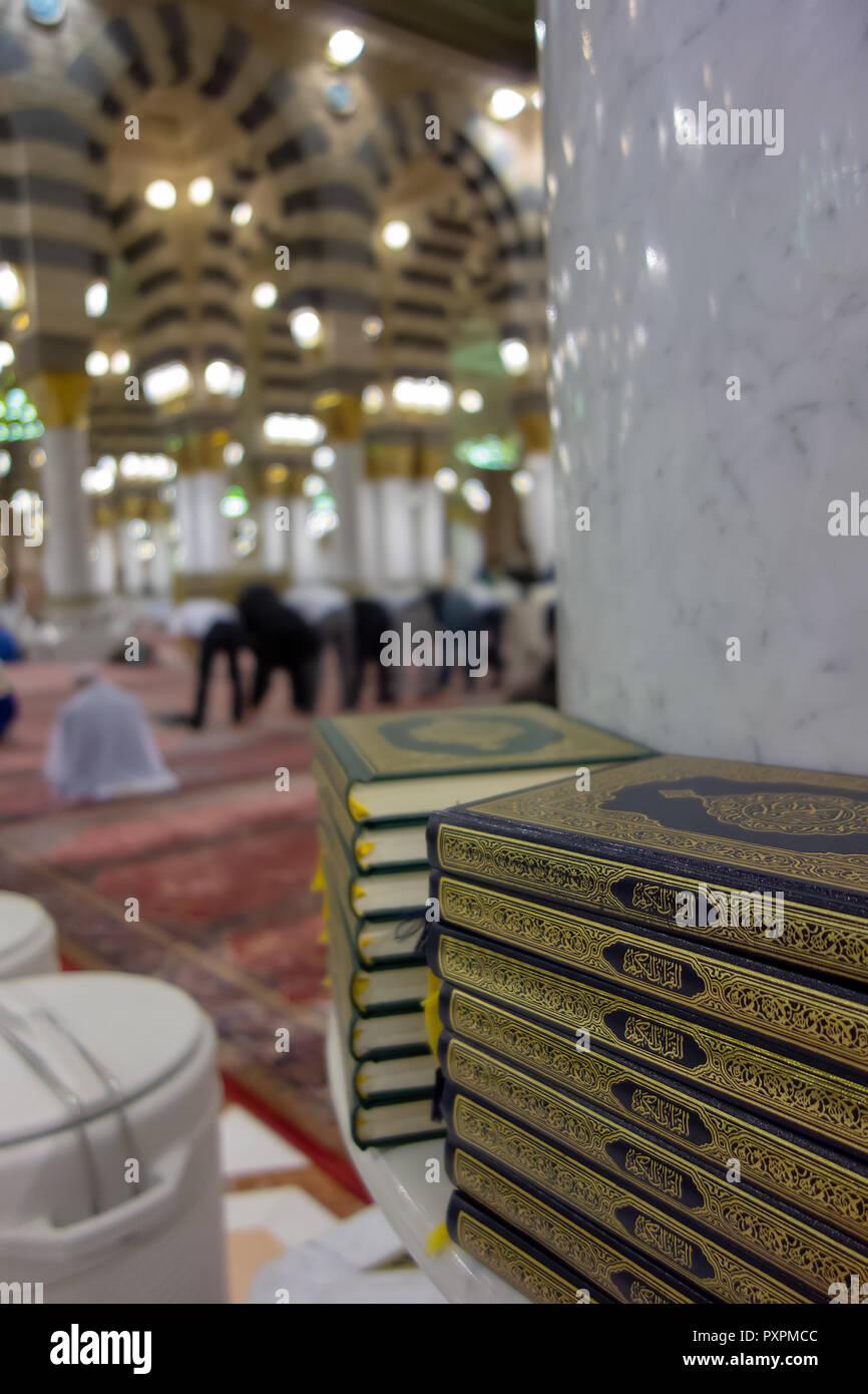 Stack of Quran (Koran) inside a mosque in Medina, Saudi Arabia in toned. - Stock Image