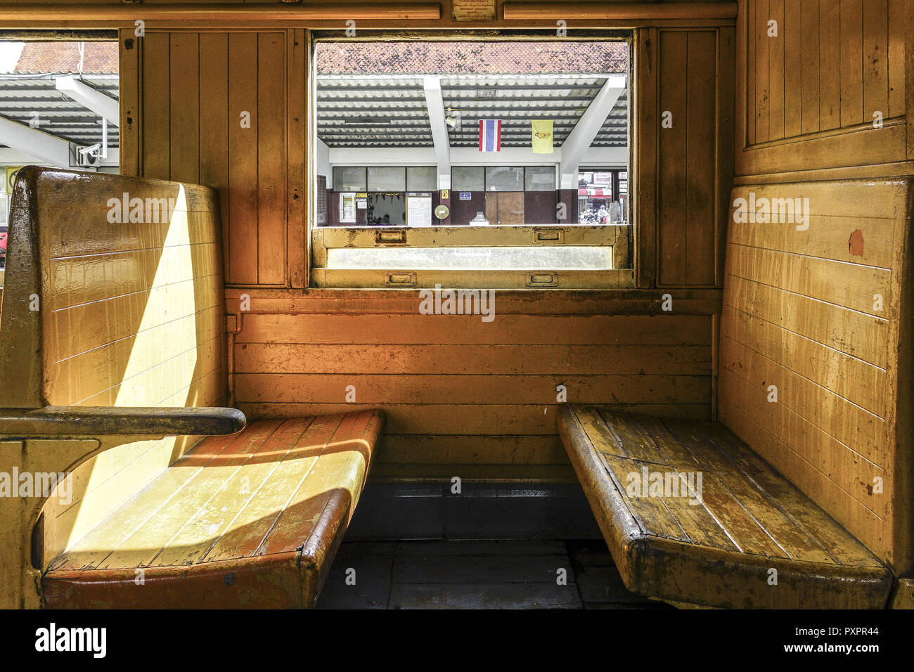 Old Train Passenger Carriage With Wooden Bench Seat Stock Photo