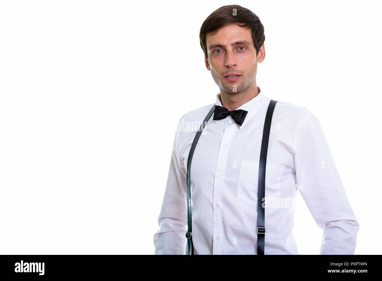 ebc7f57a67b3 Studio shot of young handsome man wearing suspenders and bow tie - Stock  Image