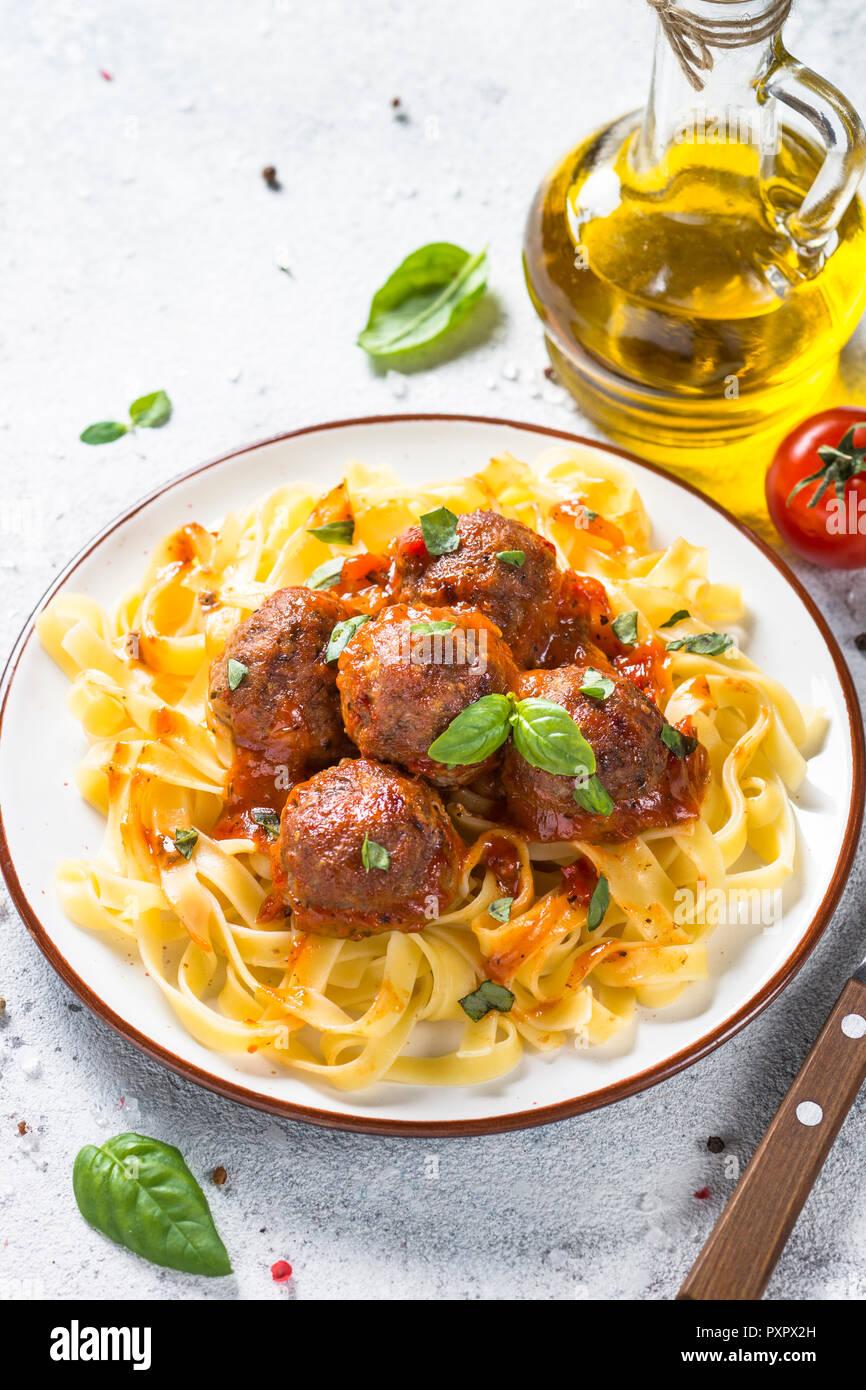 Meatballs in tomato sauce with pasta tagliatelle. - Stock Image