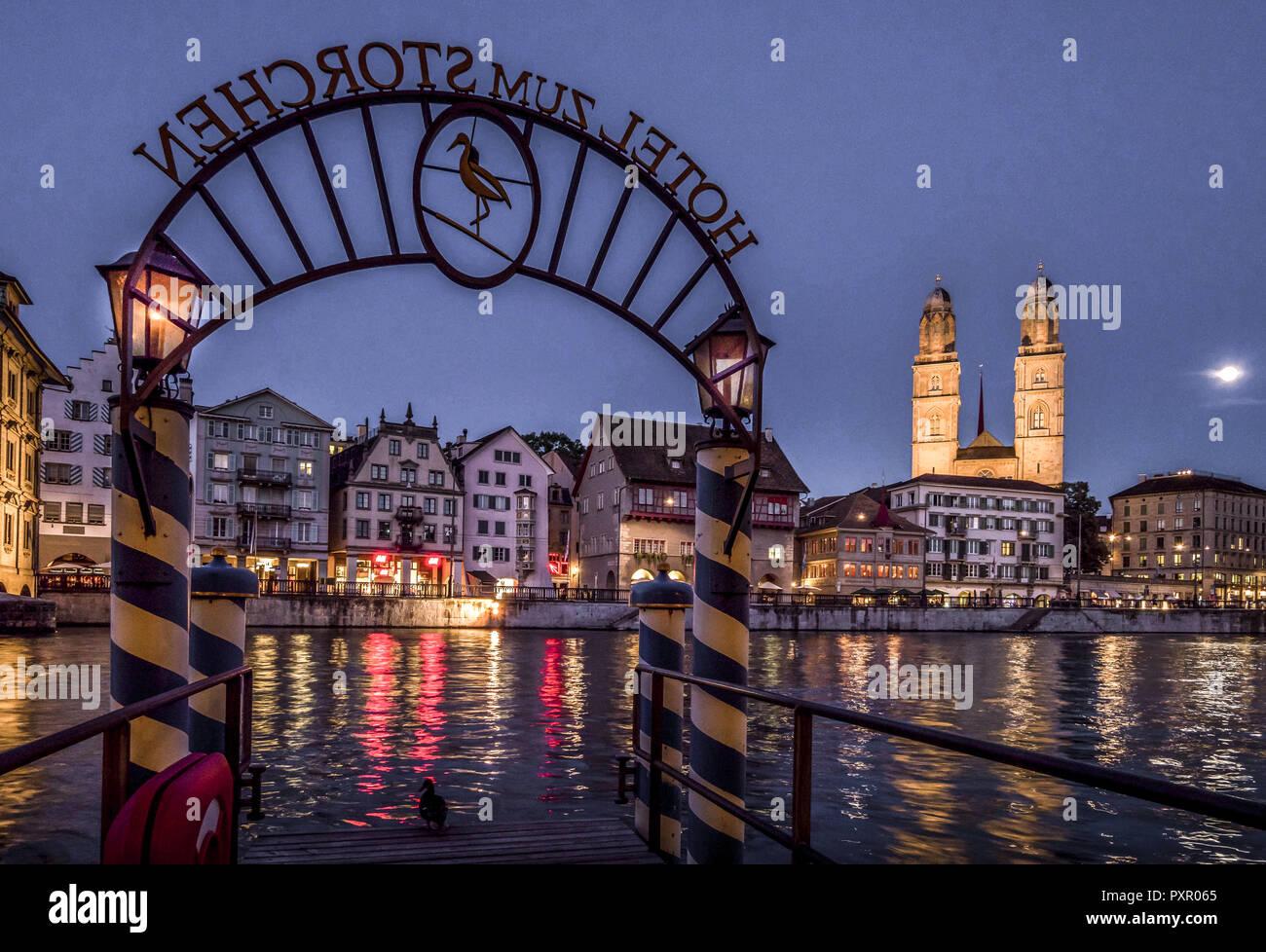 Limmatquai and Grossmunster in Zurich at Night, Switzerland - Stock Image