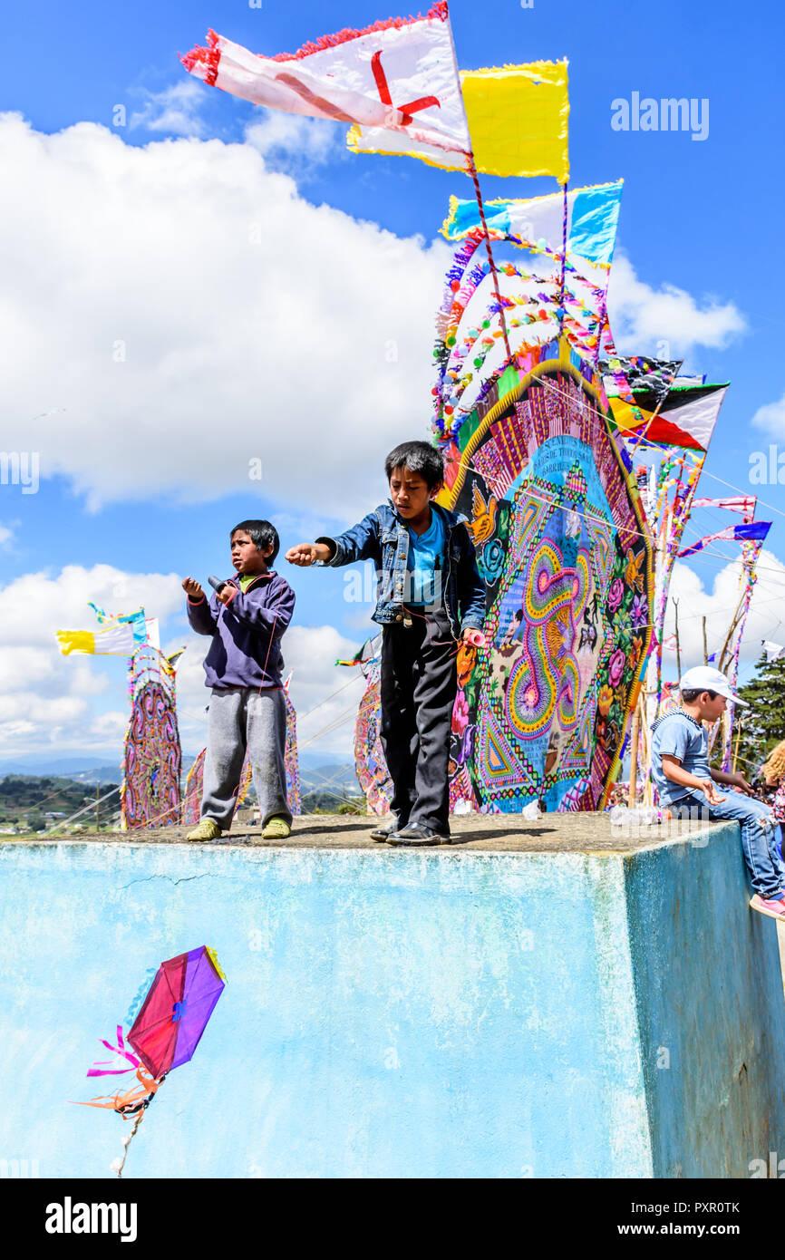 Santiago Sacatepequez, Guatemala - November 1, 2017: Flying kites in cemetery during Giant kite festival honoring spirits of dead on All Saints Day. - Stock Image