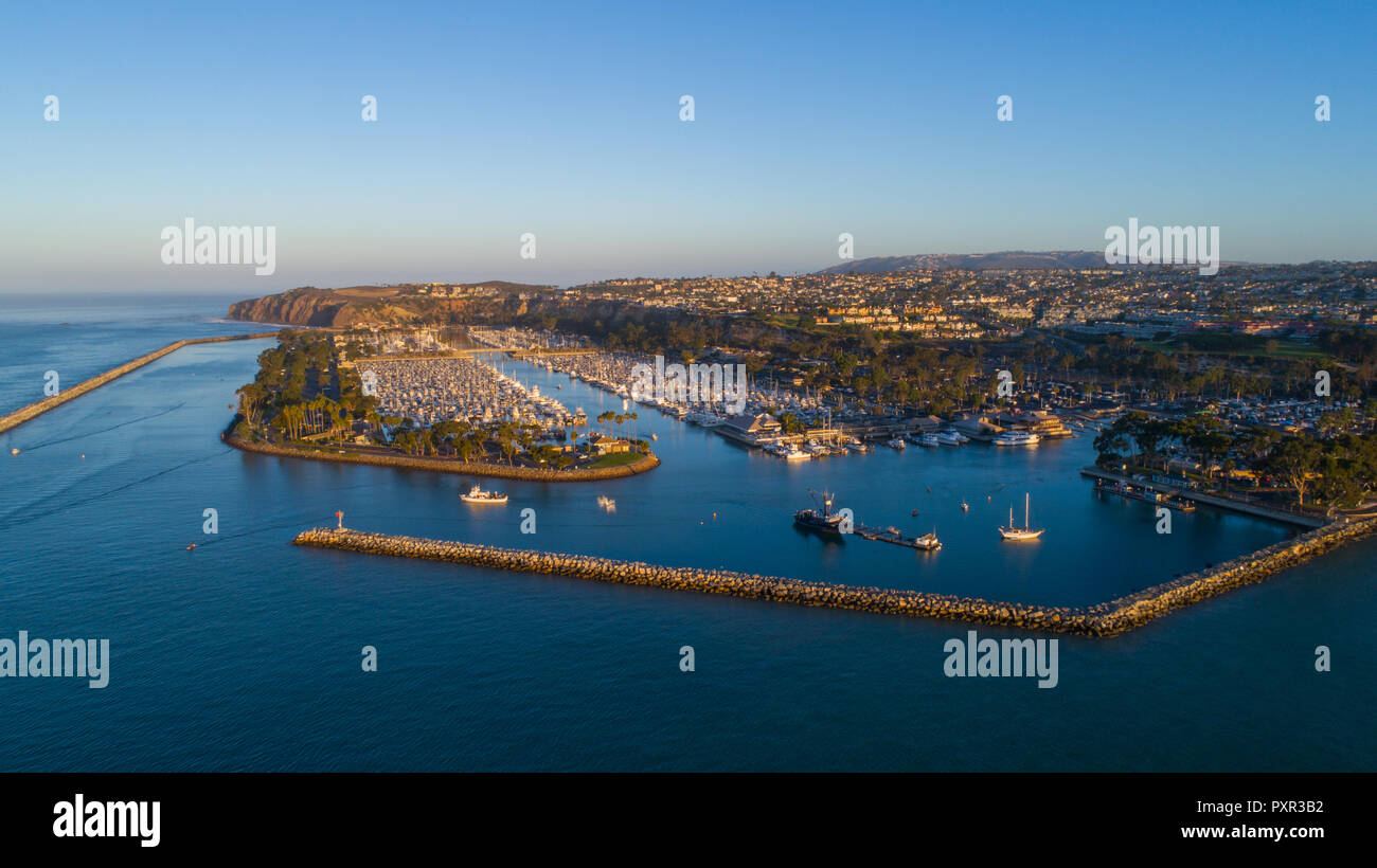 Doheny state beach, drone image of Dana Point Harbor Sunrise In October.  Beautiful sunrise aerial shots of Boats in the harbor. Drone photography. - Stock Image