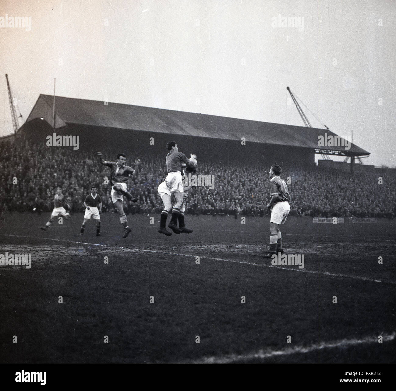1950s, historical, a football match at the Old Den, New Cross, London SE14, the home of Millwall FC, established in 1885. The large ground which opened in 1910 and while in use was known as 'The Den', could take 47,000 spectators, with over 43,000 of these standing. The main stand full of spectators can be seen in the picture. - Stock Image