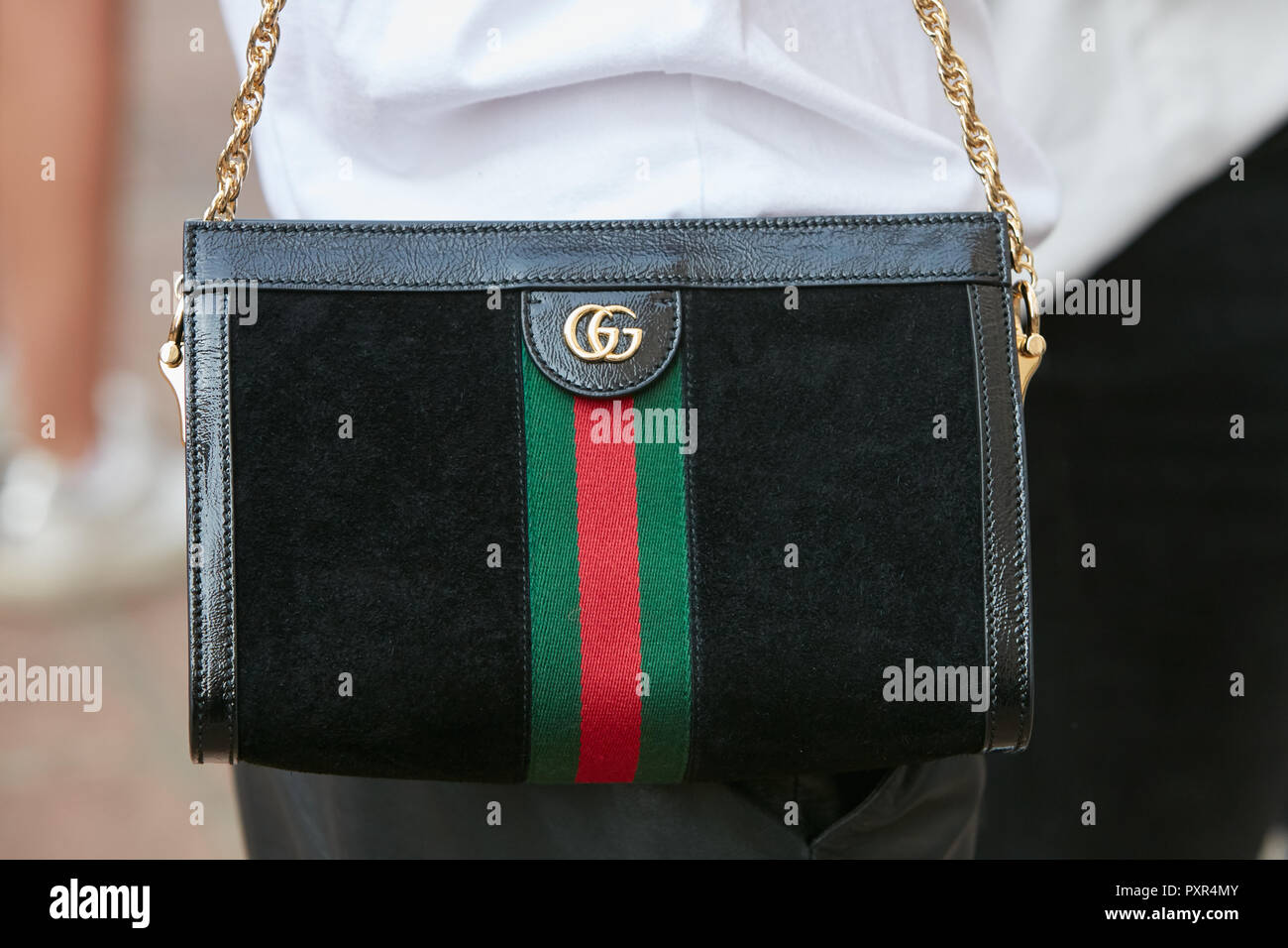 MILAN, ITALY , SEPTEMBER 22, 2018 Woman with black Gucci