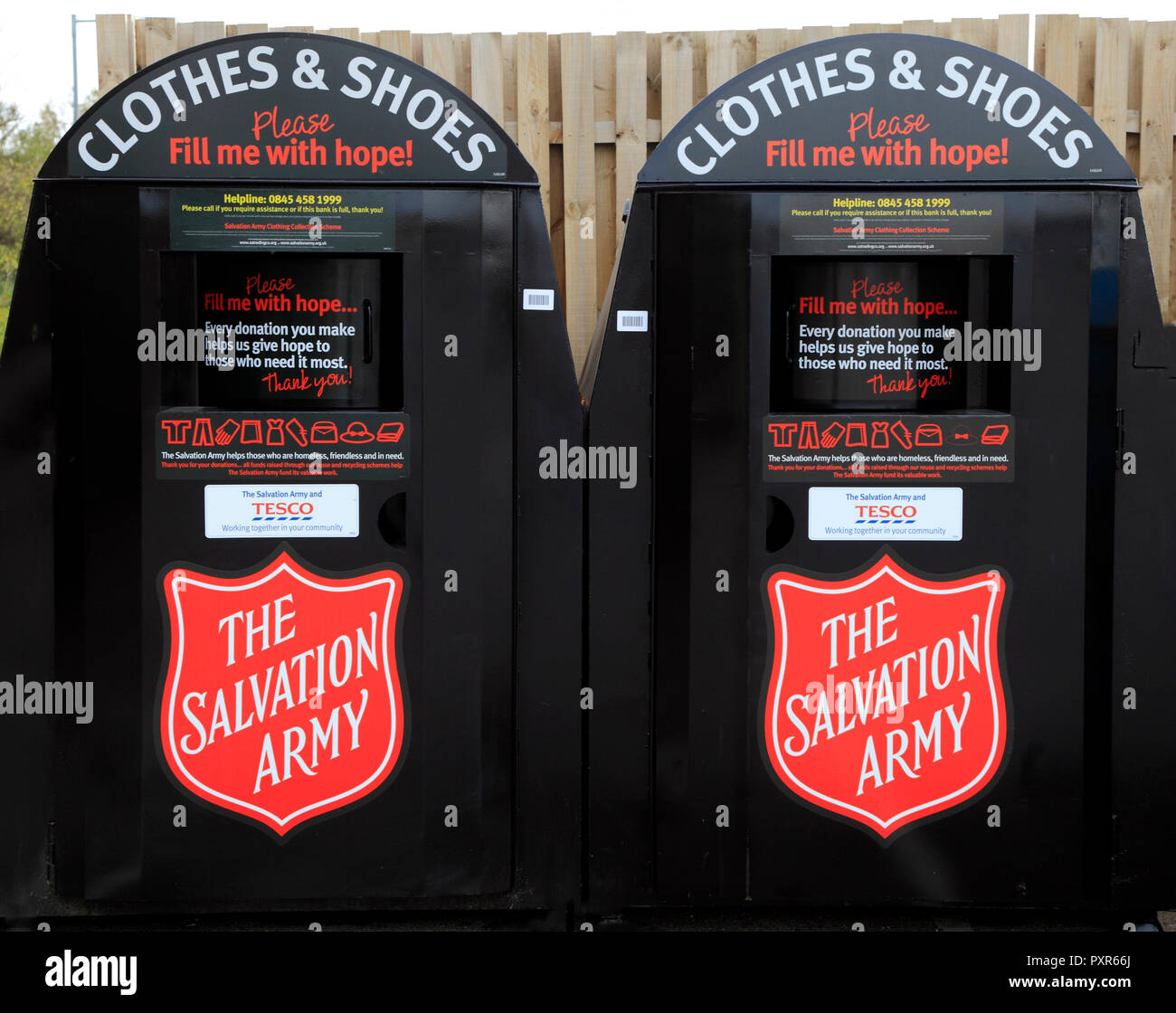 The Salvation Army, collection bins, Clothes and Shoes, charity, receptacle, with Tesco - Stock Image
