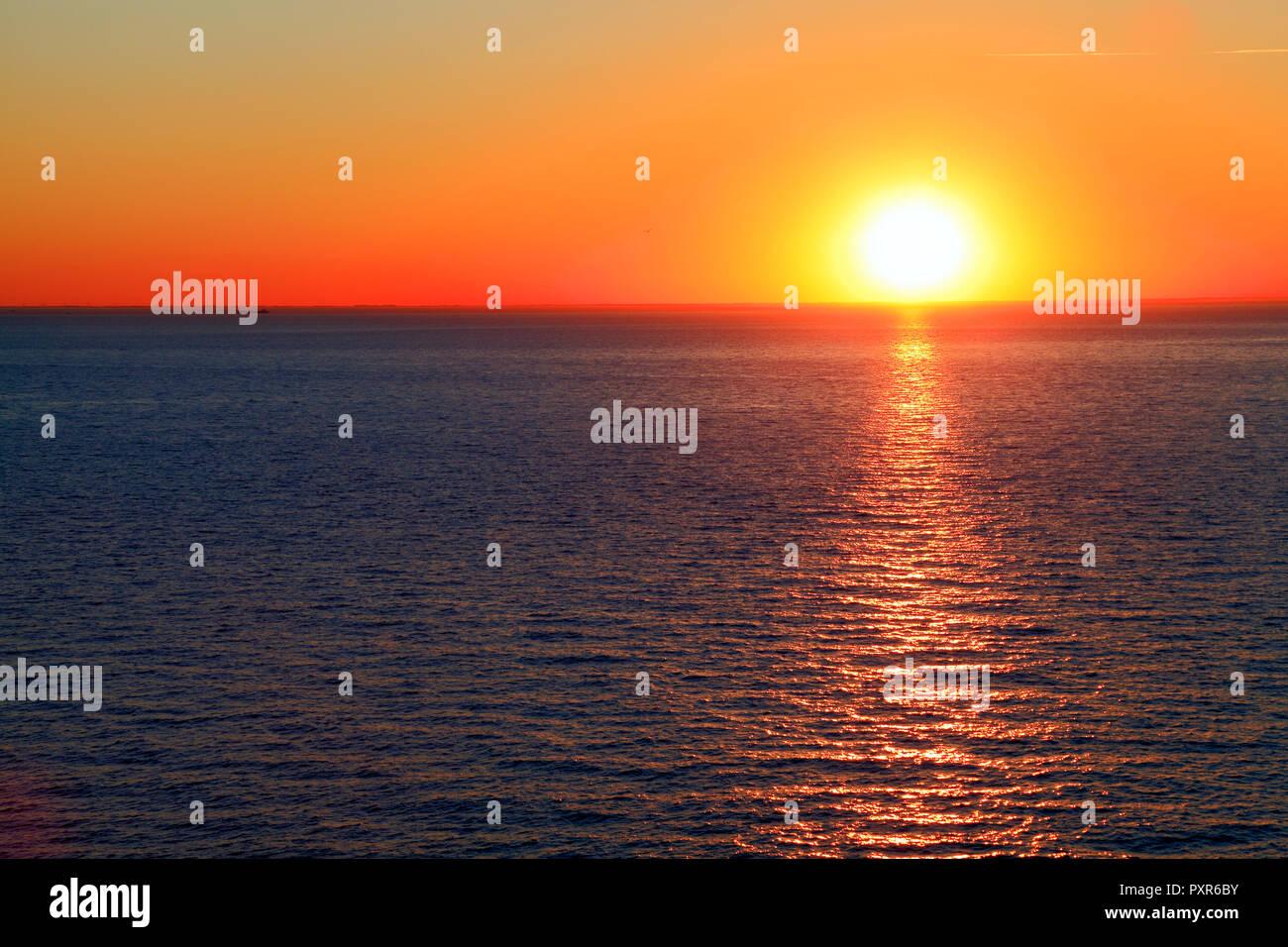 Sunset, over Sea, red sky, The Wash, west facing coast, Hunstanton, Norfolk, England UK - Stock Image