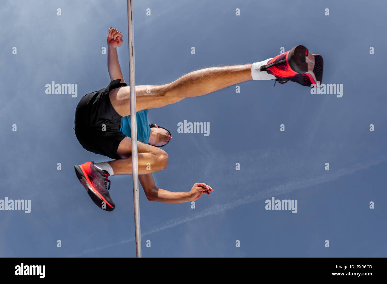 Hurdler, worm's eye view - Stock Image