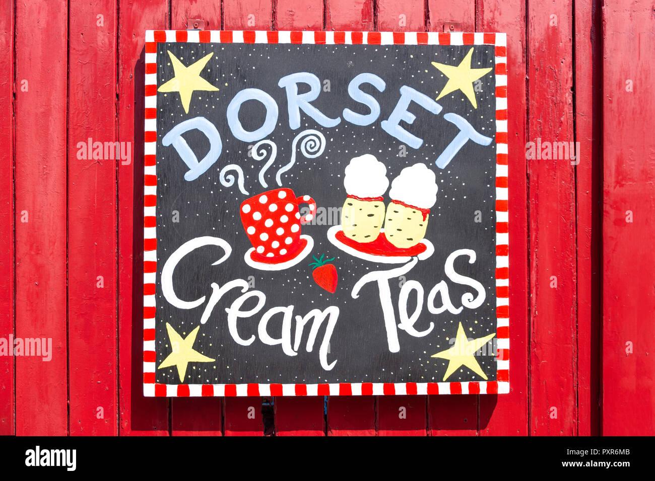Dorset Cream Teas tearoom sign, Corfe Castle, Isle of Purbeck, Dorset, England, United Kingdom - Stock Image