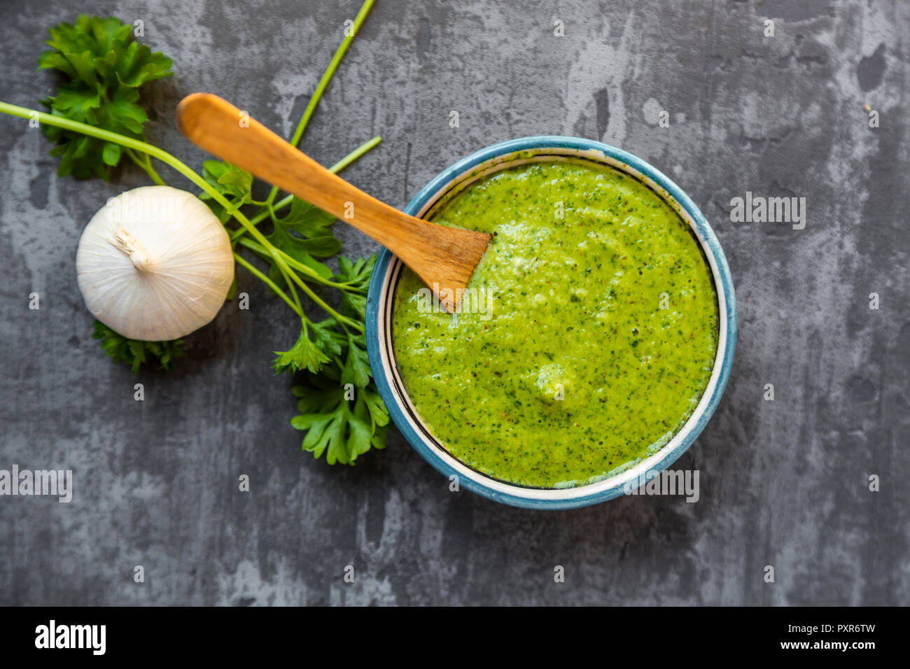 Argentinian chimichurri verde, barbecue sauce, overhead view Stock Photo