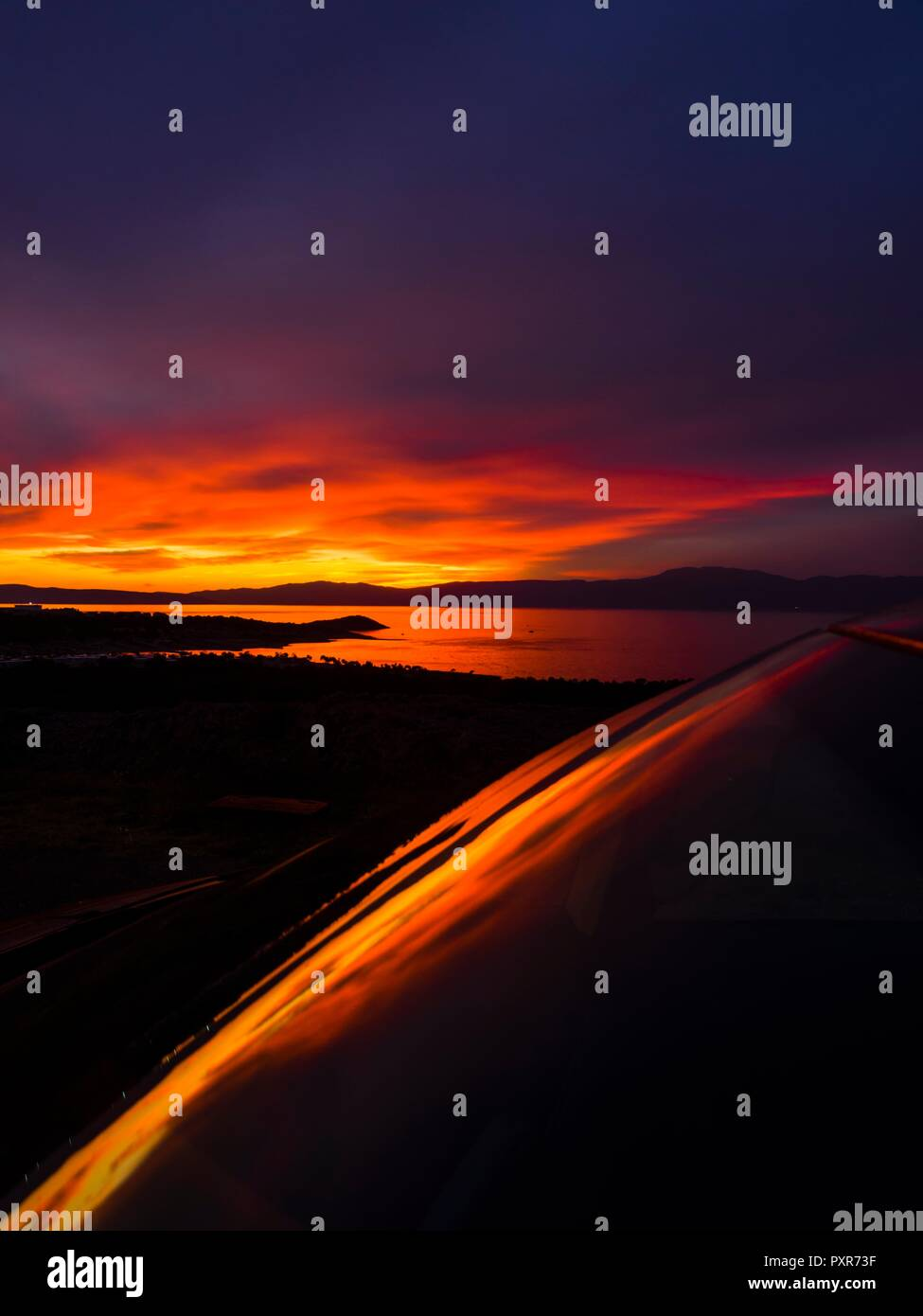 Stunning car frontal windshield almost diagonal vertical sunset - Stock Image