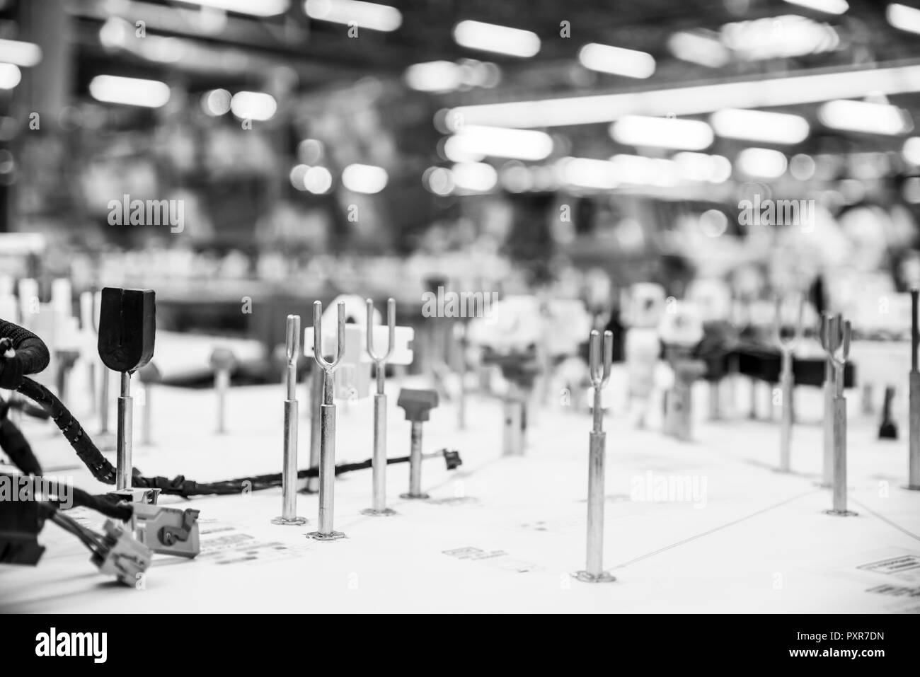 Automotive industry, manufacturing wiring harnesses. Monochrome industrial background with copy space Stock Photo