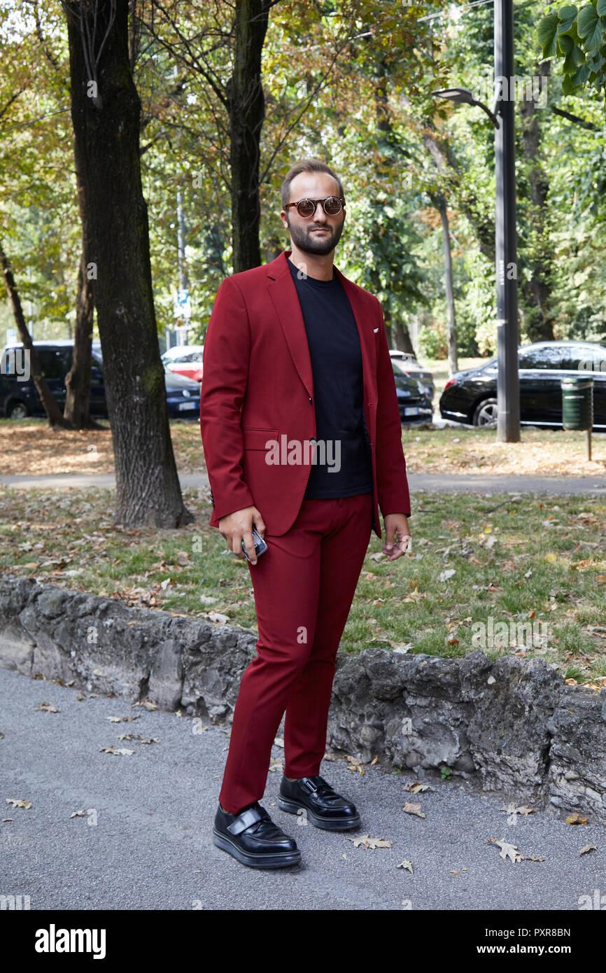 MILAN, ITALY , SEPTEMBER 22, 2018 Man with dark red jacket