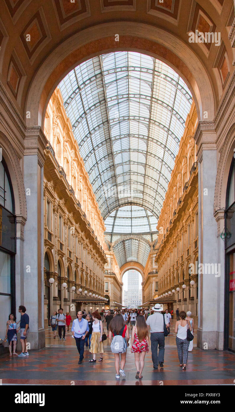 Exploring the vast spaces and high end shopping found in one of the world's most noted shopping malls, the Galleria Vittorio Emanuele II, is one of th - Stock Image