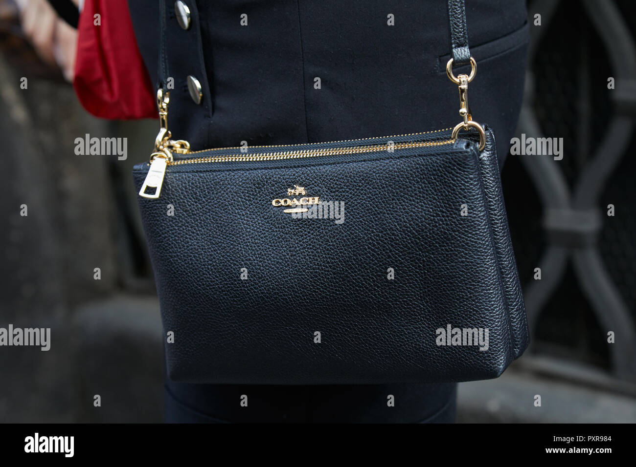c36c1a5252145 MILAN, ITALY - SEPTEMBER 22, 2018: Woman with black leather Coach bag before