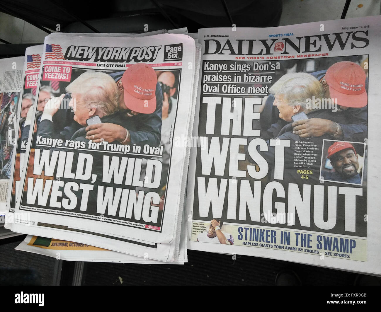Headlines of New York newspapers on Friday, October 12, 2018 use similar wire service photographs to report on the previous day's meeting between President Donald Trump and celebrity Kanye West. (© Richard B. Levine) - Stock Image