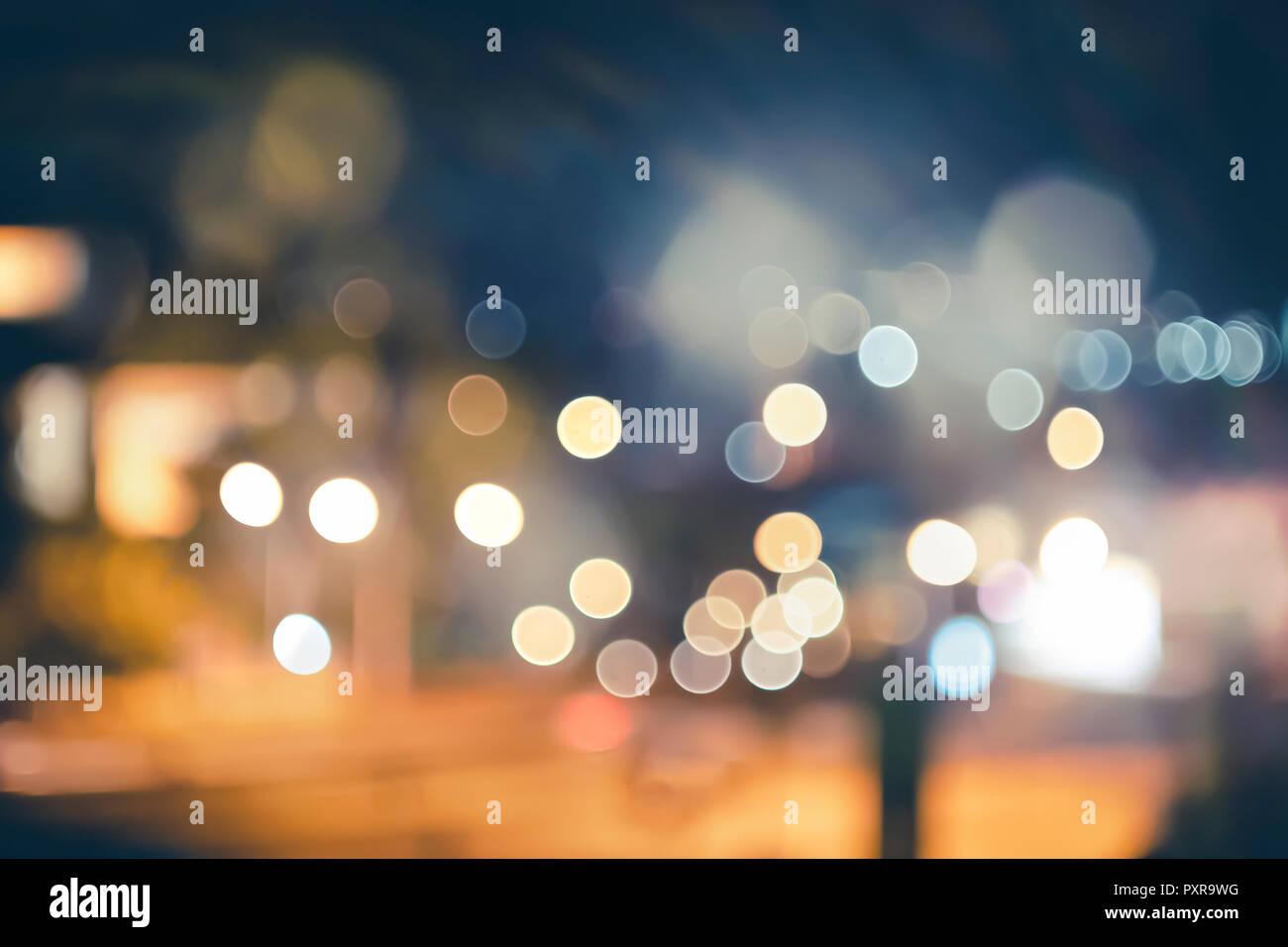 night city street lights bokeh background,lights blurred bokeh background for your design vintage or retro color - Stock Image