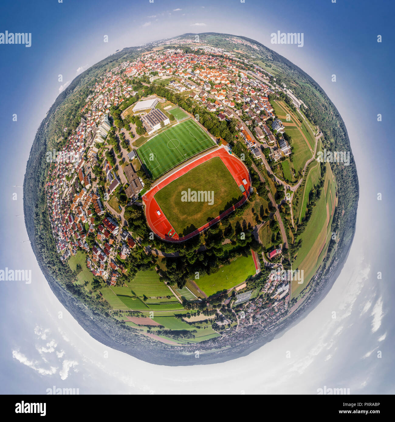 Germany, Baden-Wuerttemberg, Winterbach, Little planet view of track and field stadium - Stock Image