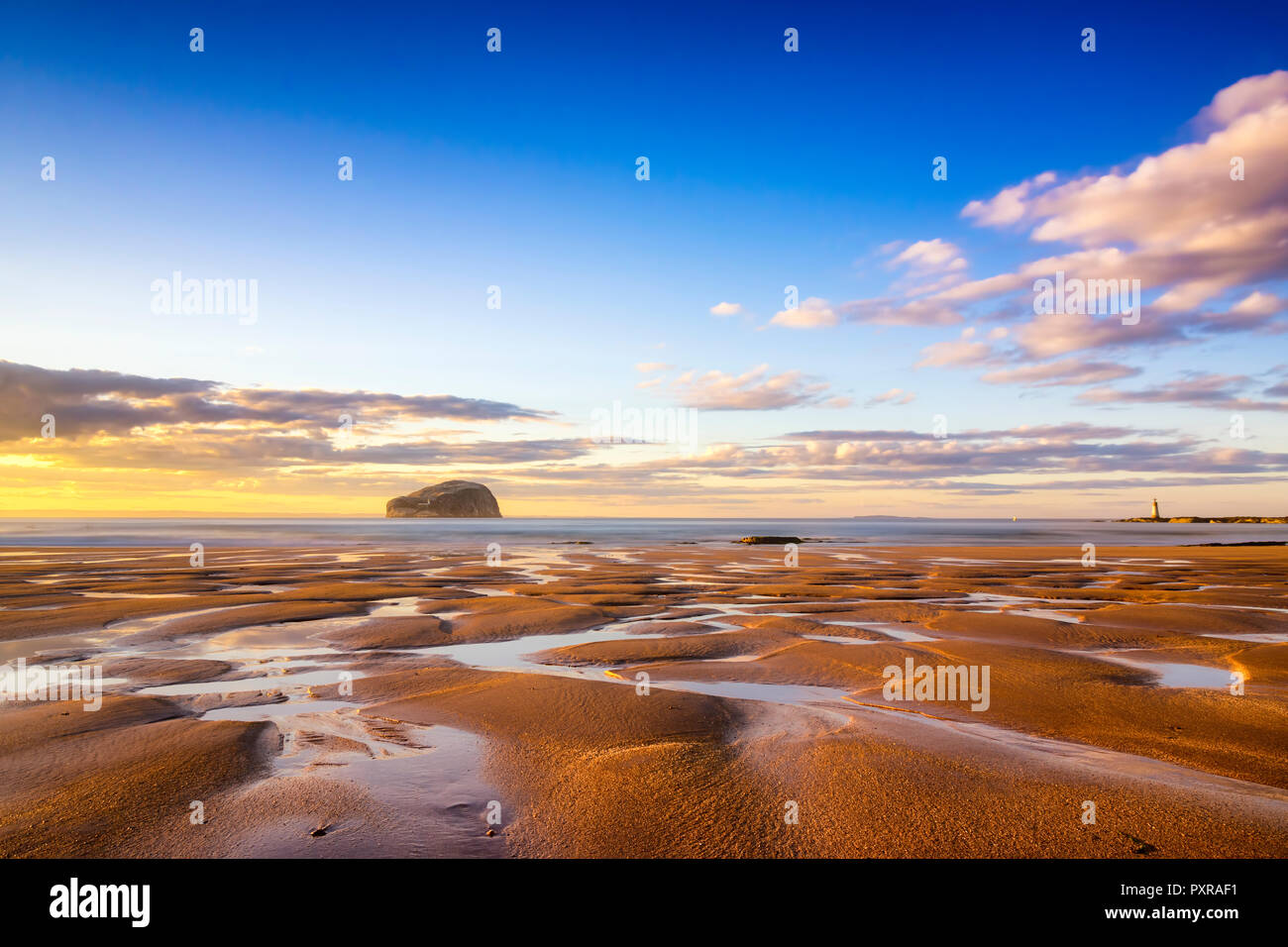 UK, Scotland, East Lothian, North Berwick, Firth of Forth, view of Bass Rock (world famous Gannet Colony) at sunset, Lighthouse, sand, beach Stock Photo
