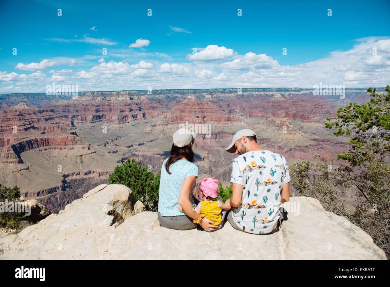 USA, Arizona, Grand Canyon National Park, South Rim, Family sitting on viewpoint - Stock Image