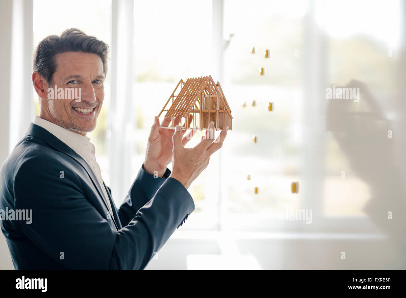 Mature businessman sharing his knowledge with younger colleague - Stock Image