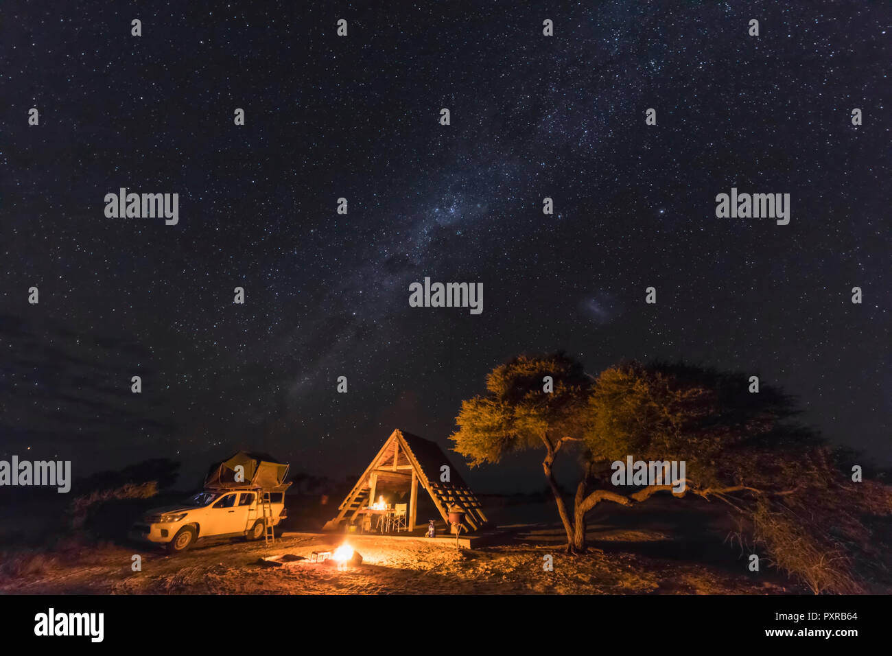 Africa, Botswana, Kgalagadi Transfrontier Park, Mabuasehube Game Reserve, Camping ground under starry sky - Stock Image