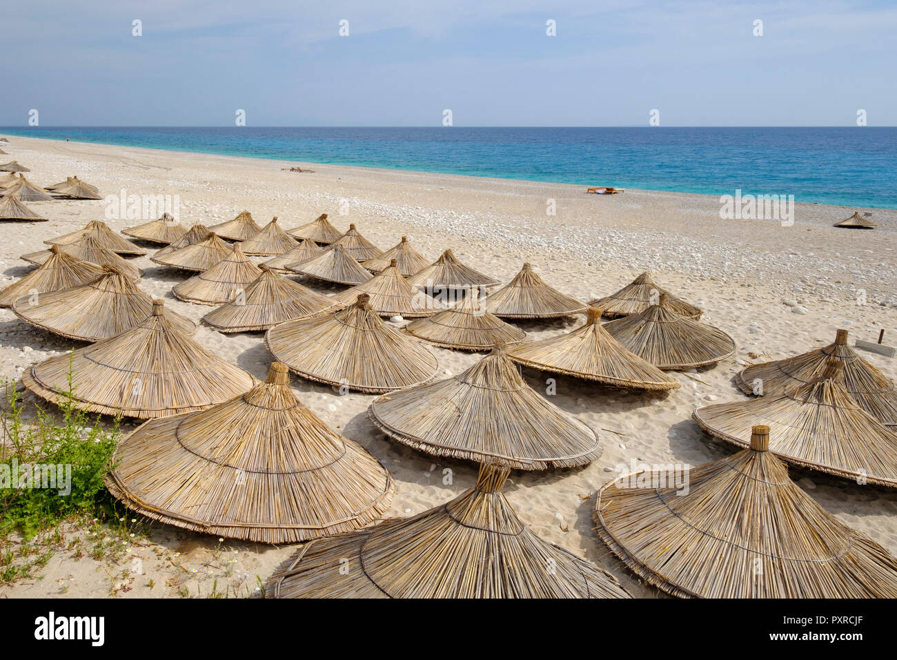Albania, Ionean sea, Albanian Riviera, sunshades on the beach of Dhermi - Stock Image