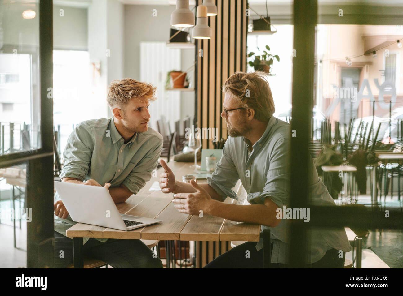 Business partners having a meeting in their new start-up company - Stock Image