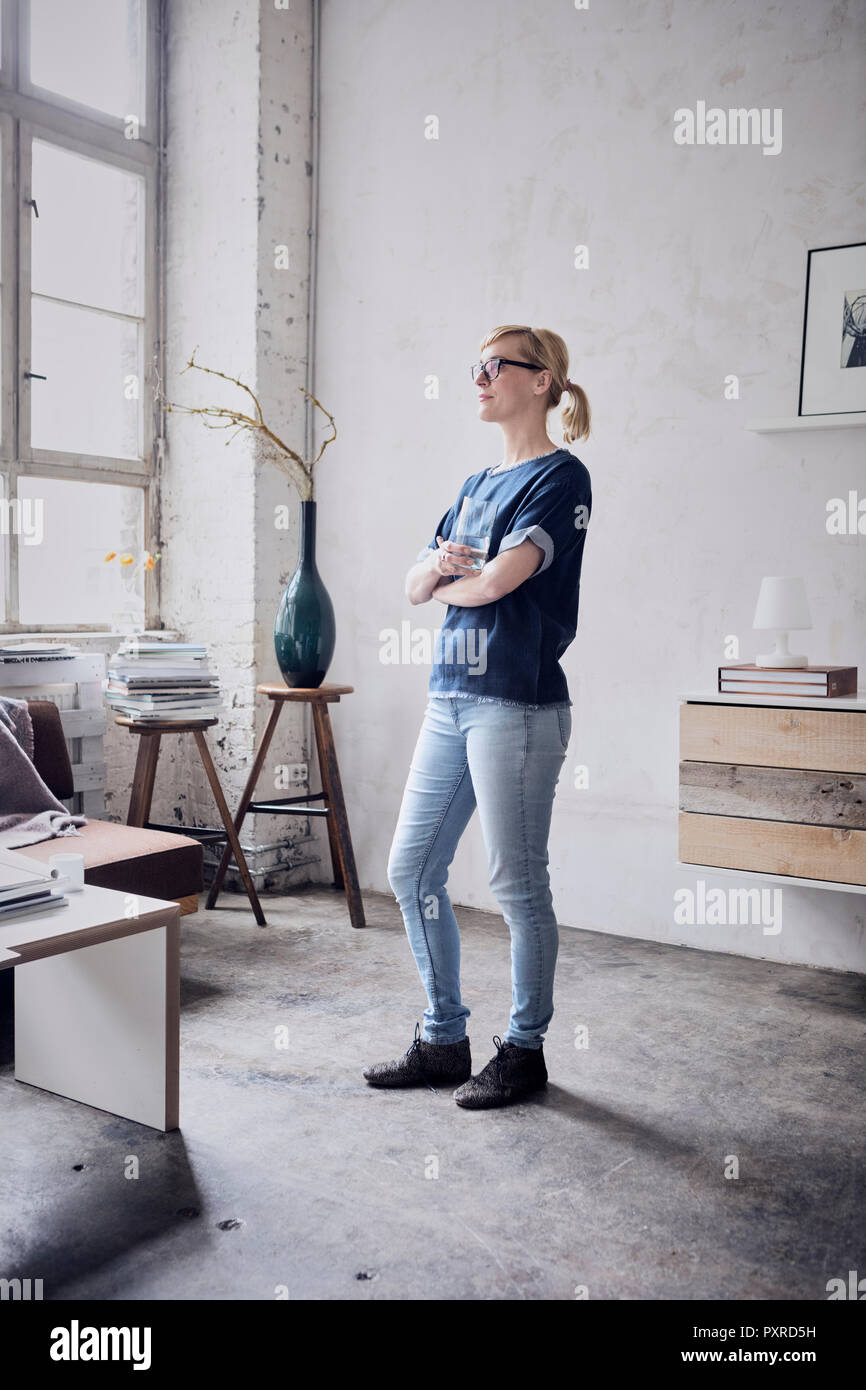 Woman standing in a loft - Stock Image