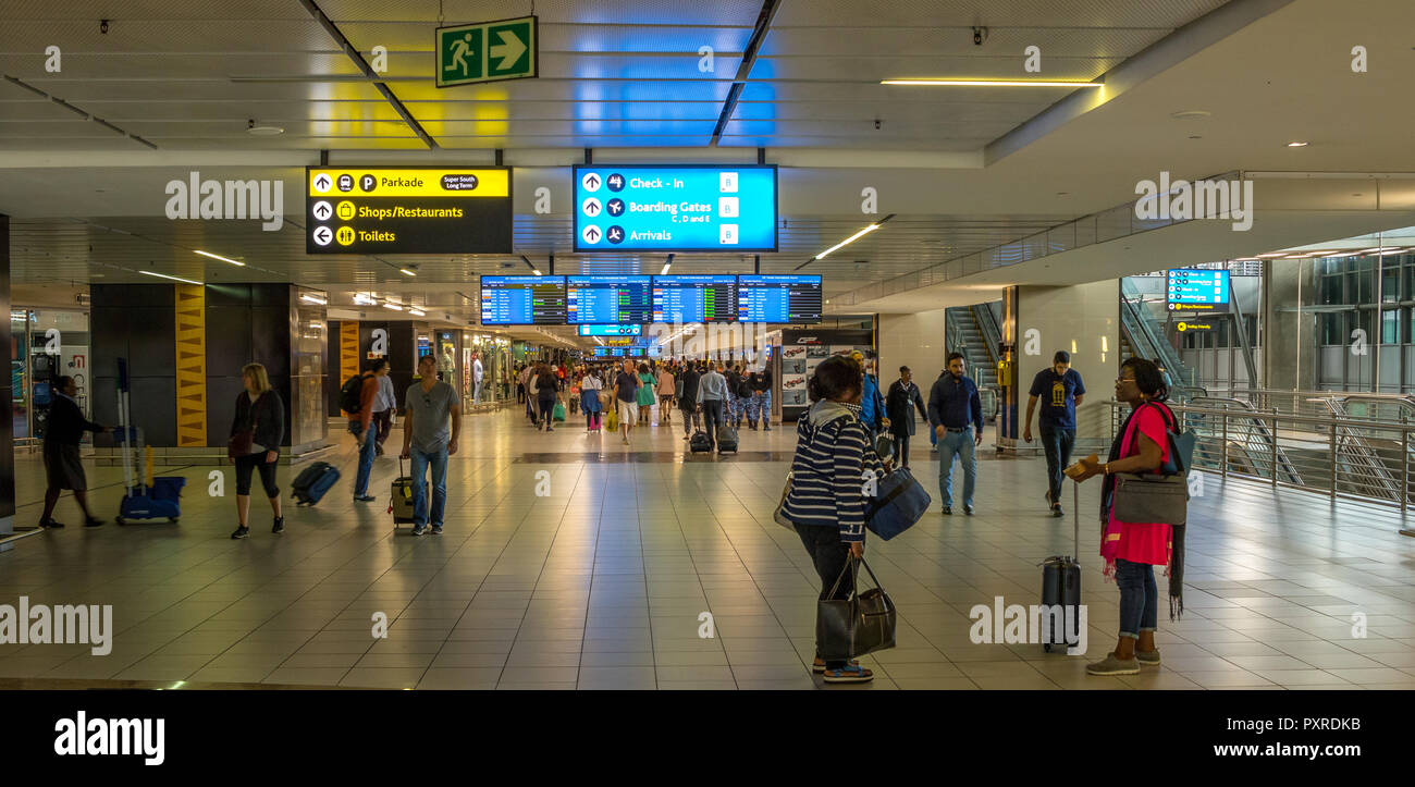 Johannesburg, South Africa - unidentified arriving and departing passengers at the modern O.R.Tambo International Airport in the city - Stock Image