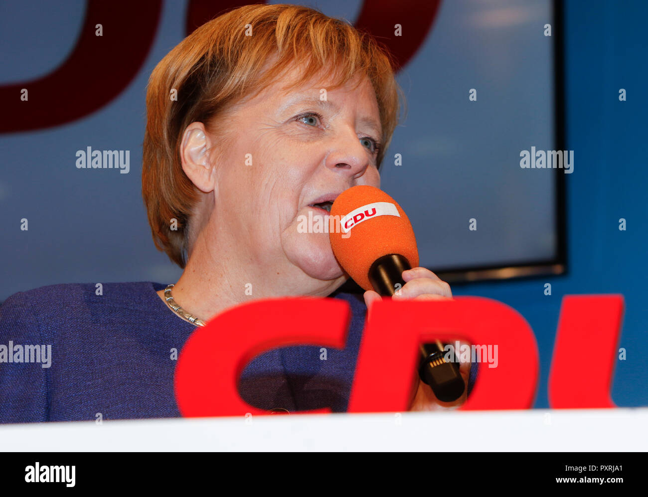 Dieburg, Germany. 23rd October 2018. Angela Merkel, the Chancellor of Germany, speaks at the election rally. German Chancellor Angela Merkel attended a political rally of her CDU party in Dieburg ahead of the upcoming state election in the German state of Hesse. With less than a week to go to the election, the CDU is still leading the polls, but gas lost more than 10% compared to the last election. - Stock Image