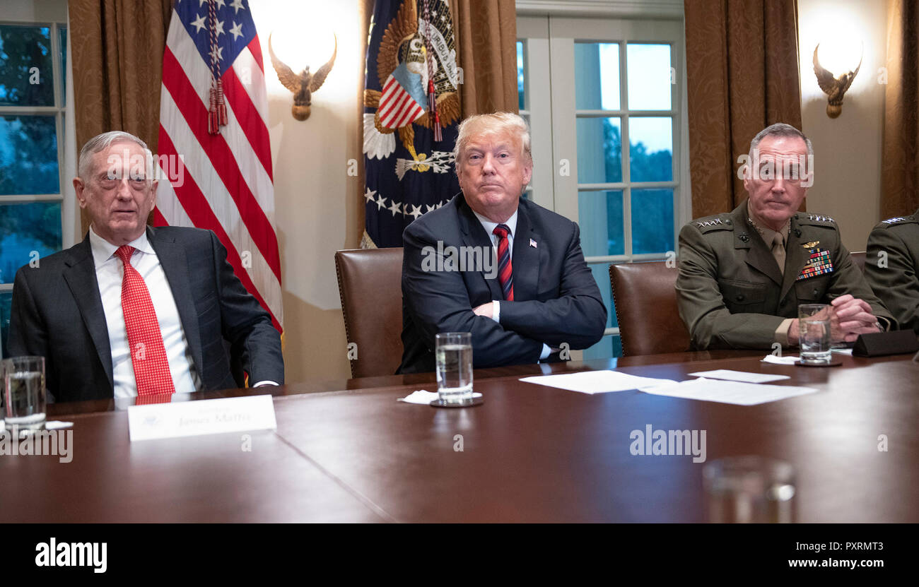 United States President Donald J. Trump, center, makes a statement to the media as he prepares to receive a briefing from senior military leaders in the Cabinet Room of the White House in Washington, DC on Tuesday, October 23, 2018. The President took questions on the proposed space force, immigration, the caravan and Saudi actions in the killing of Jamal Khashoggi. At left is US Secretary of Defense James Mattis and at right is US Marine Corps General Joseph F. Dunford, Chairman of the Joint Chiefs of Staff. Credit: Ron Sachs/Pool via CNP | usage worldwide Stock Photo