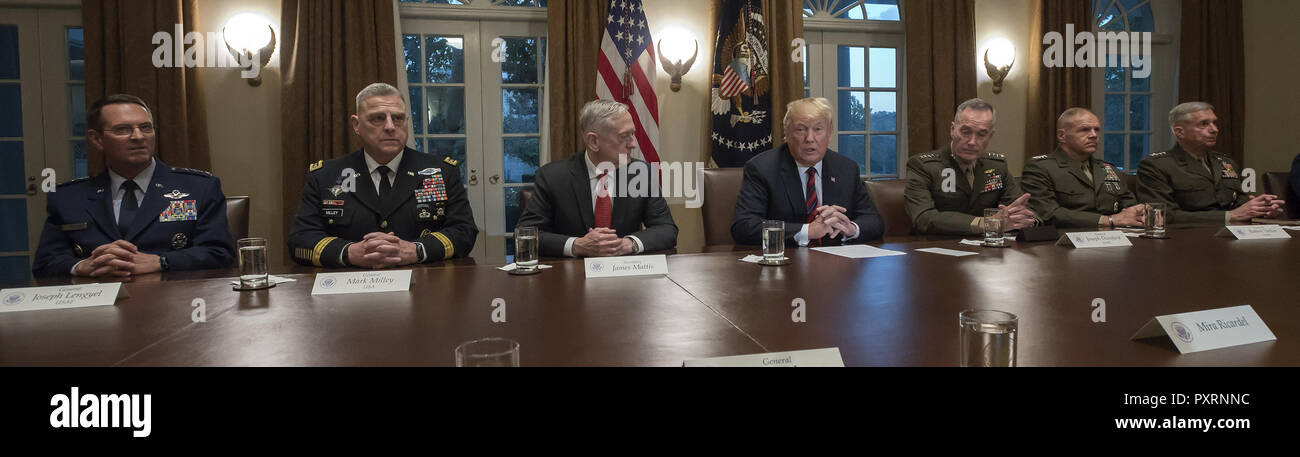 October 23, 2018 - Washington, District of Columbia, U.S. - United States President Donald J. Trump makes a statement to the media as he prepares to receive a briefing from senior military leaders in the Cabinet Room of the White House in Washington, DC on Tuesday, October 23, 2018. The President took questions on the proposed space force, immigration, the caravan and Saudi actions in the killing of Jamal Khashoggi. From left to right: US Air Force General Joseph L. Lengyel, Chief of the National Guard Bureau; US Army General Mark A. Milley, Chief of Staff of the Army; US Secretary of Defens Stock Photo