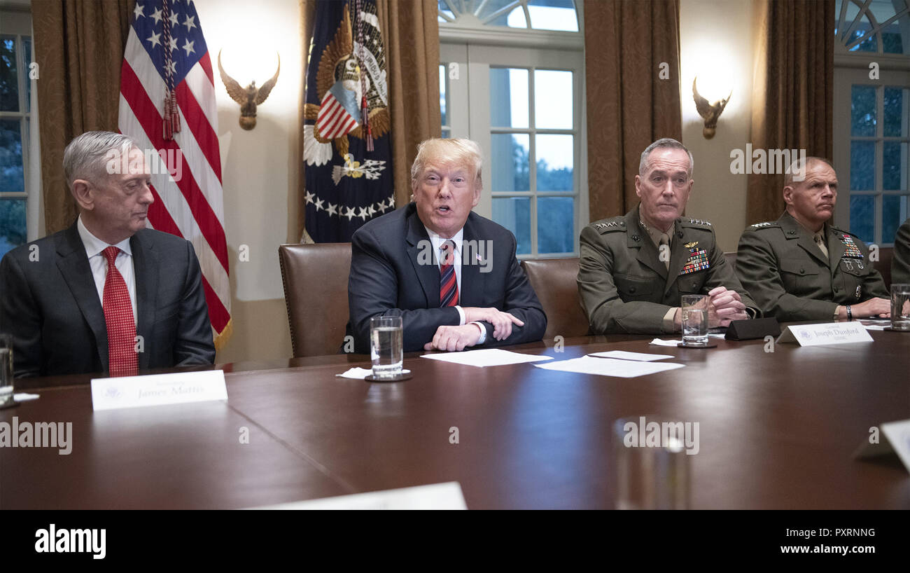 October 23, 2018 - Washington, District of Columbia, U.S. - United States President Donald J. Trump makes a statement to the media as he prepares to receive a briefing from senior military leaders in the Cabinet Room of the White House in Washington, DC on Tuesday, October 23, 2018. The President took questions on the proposed space force, immigration, the caravan and Saudi actions in the killing of Jamal Khashoggi. From left to right: US Secretary of Defense James Mattis; the President; US Marine Corps General Joseph F. Dunford, Chairman of the Joint Chiefs of Staff, and US Marine Corps Gen Stock Photo