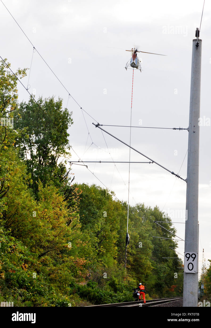 Vetschau, Germany. 24th Oct, 2018. 24 October 2018, Germany, Vetschau: A helicopter trims the trees on the section between Vetschau and Cottbus. Over a distance of 20 kilometres, the trees on both sides of the tracks are cut back. Credit: Anna Ringle/dpa-Zentralbild/ZB/dpa/Alamy Live News - Stock Image